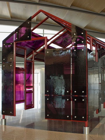 Mildred Howard, <em>The House That Cannot Be Any Color Than It's Own, </em> 2011 <span>10.5 x 11 x 9 feet; clear mirrored glass laminated hand-blown aubergine art glass</span>