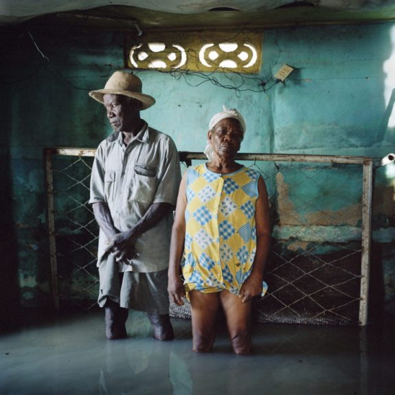 Gideon Mendel, <em> Christa and Salomon Raymond Fils. Decade Village, Haiti, September 2008.</em><span>Lightjet C type photographic print on Fuji Crystal Archive Paper, 100 x 100 cm</span>