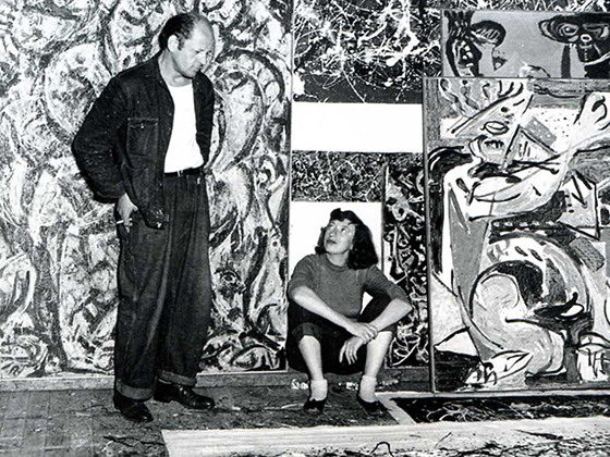 Jackson Pollock and Lee Krasner in Pollock's studio, East Hampton, 1949. <span> Photograph by Lawrence Larkin. © Pollock-Krasner House and Study Center, East Hampton, NY. Used by permission. </span>